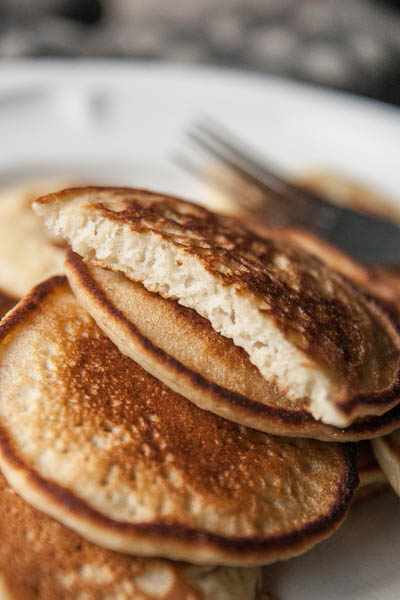 soft fluffy coconut cream pancakes two spoons